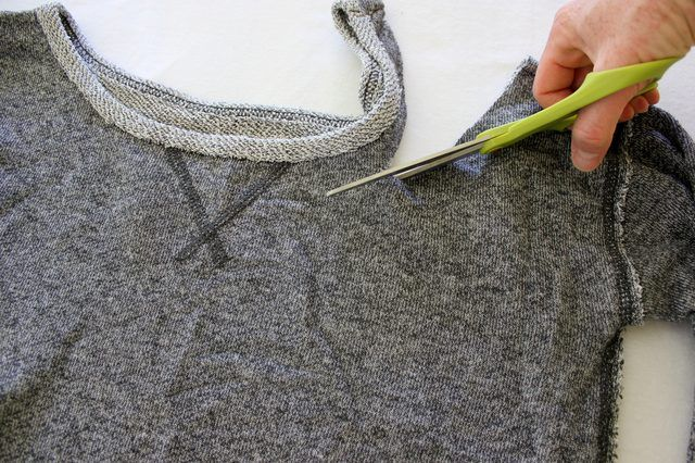 """If you're going for an 1980s look, be it for a costume party or just as a throwback to a different era, cutting a sweatshirt is one of the easiest ways. An '80s sweatshirt conjures up the iconic image of Jennifer Beals in """"Flashdance"""" -- and all the sweatshirt-inspired fashion that followed. Cutting a sweatshirt for an '80s look is easy..."""
