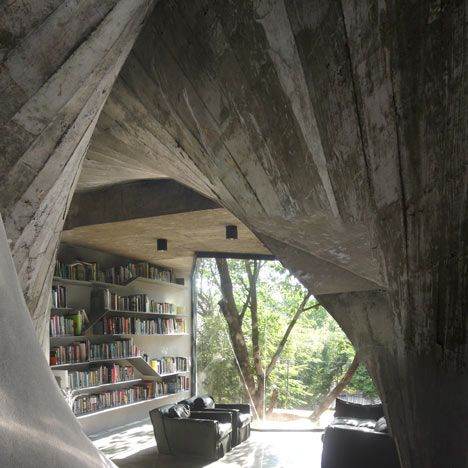 Concrete walls twist up through the interior of this tea house and library.