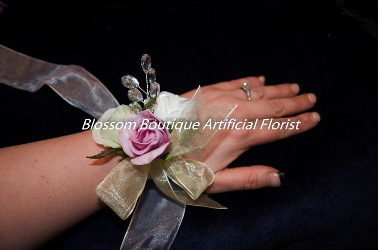 Gorgeous Wrist corsage on a ribbon band perfect for weddings but also balls and formal occasions.   Delivery time is 12 Days  Sent by courier within New Zealand which is included in the price.