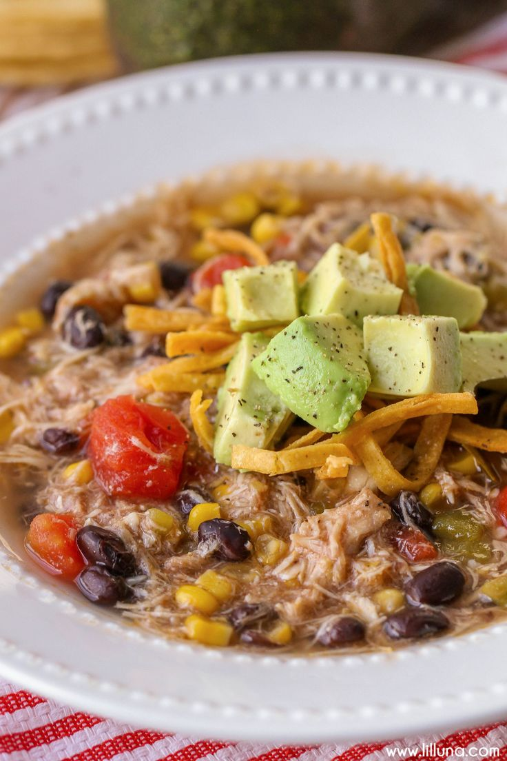 The BEST Chicken Tortilla Soup recipe - easy and delicious - the best kinds of recipes! { lilluna.com } Ingredients include chicken, avocados, tomatoes, corn, beans, green chilis, & lots of seasonings!