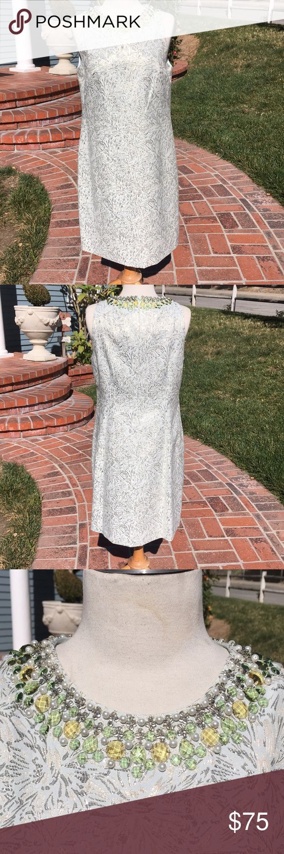 Maggy London mint green jeweled dress size 8 Maggy London mint green jeweled dress. Size 8. Gorgeous beading around neck. Dress has embedded silver metallic floral pattern. A perfect special occasion dress. Worn once, excellent condition Maggy London Dresses