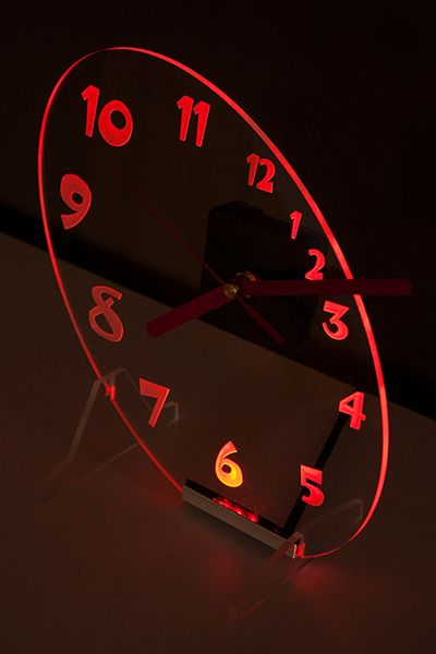 Clock with red backlight LED in the oval shape.  New design.