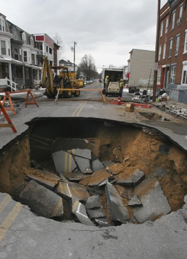 """SEE IT: Bankrupt Harrisburg, PA, can't fix the 41 sinkholes plaguing its streets. Locals took to calling the North Fourth sinkhole """"Super Sinkhole Walter,"""" and even made it a """"check in"""" location on Four Square.  Photos by Gilliland/ The Patriot-News"""