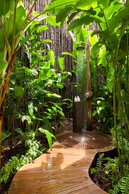 Outdoor Shower ... love the luscious green landscaping