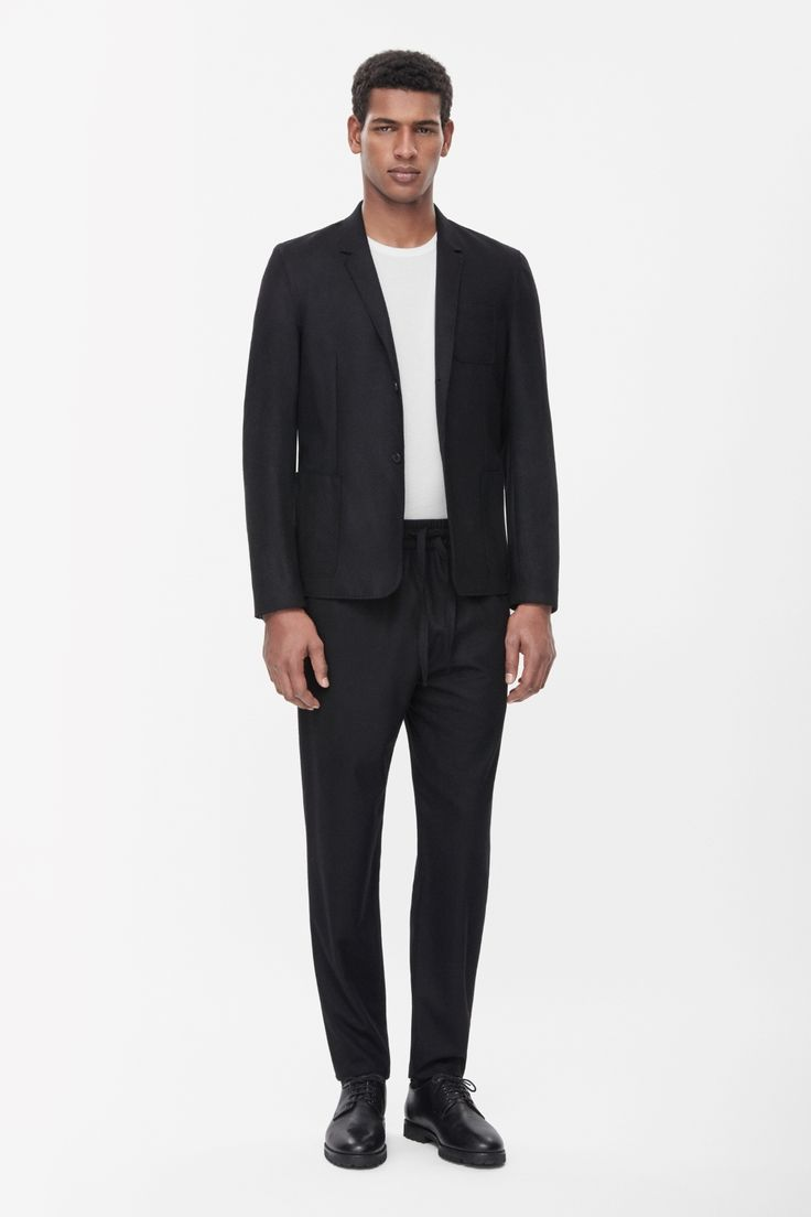 Made from an unlined blend of wool and cashmere, this modern blazer has clean raw-cut edges and seams. A straight shape with narrow notched lapels, it has a two-button fastening and front patch pockets.