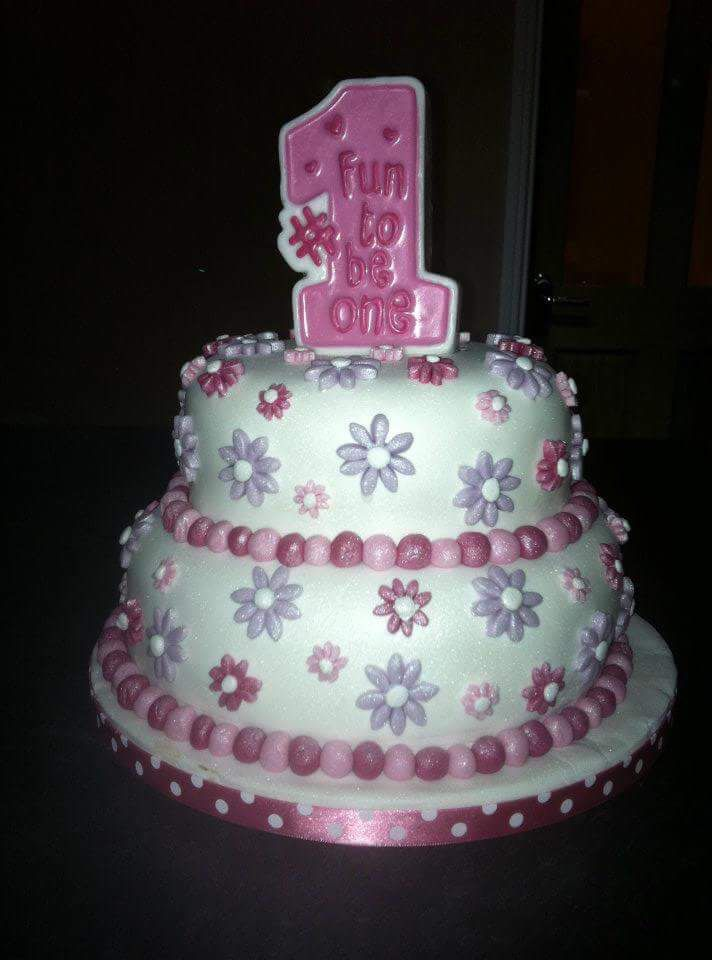 1st birthday cake. Pink and purple. Flowers. 2 tier