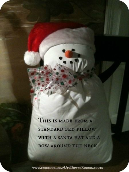 This is made from a standard bed pillow with a santa hat and a bow around the neck