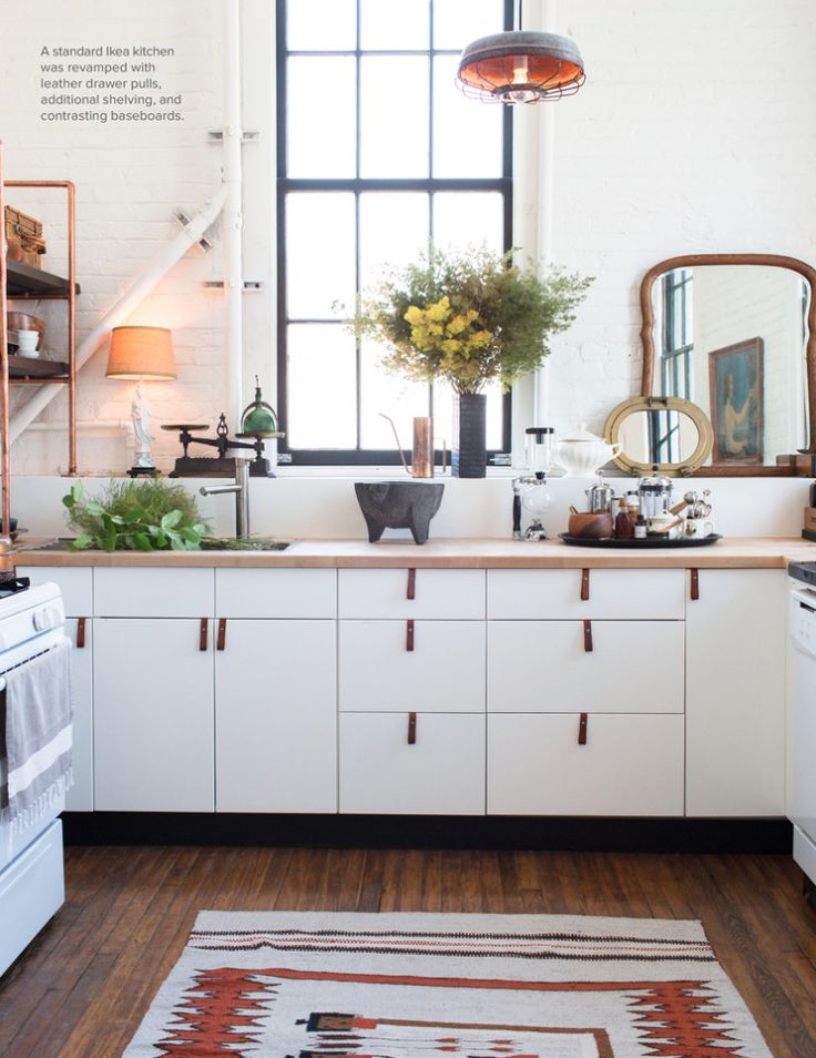 Ikea cabinets with leather pulls & black baseboards - Lonny Oct '13