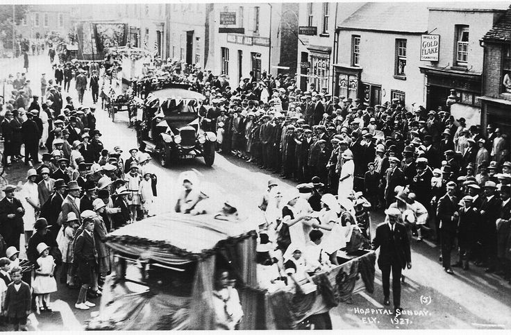 Hospital Sunday St. Mary's Street Ely 1927. On the far left Bedford House, centre Kings Arms and the barbers shop.   Commercial, Crowds, Historic, Lorries, Mixed, Urban villages   Ely