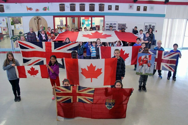 Alberta MLA Bridget Pastoor participates in a Flag Day lesson with Gr 5 classes at Father Van Tighem (via @BridgetPastoor Twitter)