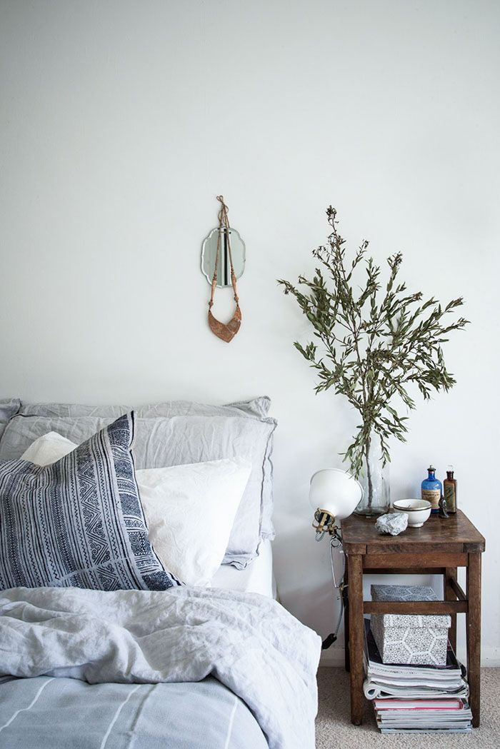 Beautiful relaxed bedroom; linen bedding; vintage stool | A Stylist's Small Space in Southeast London | Design*Sponge