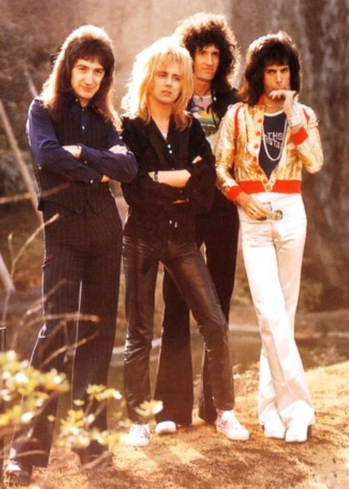 "QUEEN's ""Four Part Harmony"" . . . (Left to Right) John Deacon • Bass, Vocals 