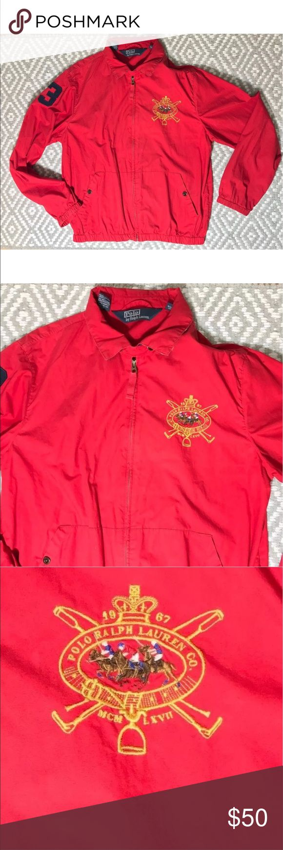 """Vintage polo Ralph Lauren red jacket with crest Vintage Ralph Lauren Polo Jacket Very Lightweight 100% cotton Zips up the front Rugby stripes under the collar Embroidered large crest on the front 3 on sleeve Elastic sleeves and around bottom hem Measurements (flat/unstretched)  Under arms across the back 24"""" Shoulder to hem down back 25"""" Shoulder to shoulder across the back 18.75""""  CONDITION: this item is slightly faded and has a few very light spots. It does not look new or mint. It does…"""