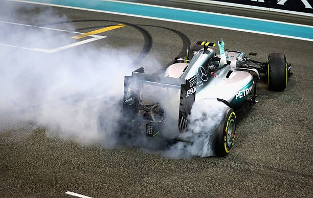Nico Rosberg of Germany and Mercedes GP does donuts on track after finishing second and securing the F1 World Drivers Championship at the Abu Dhabi...