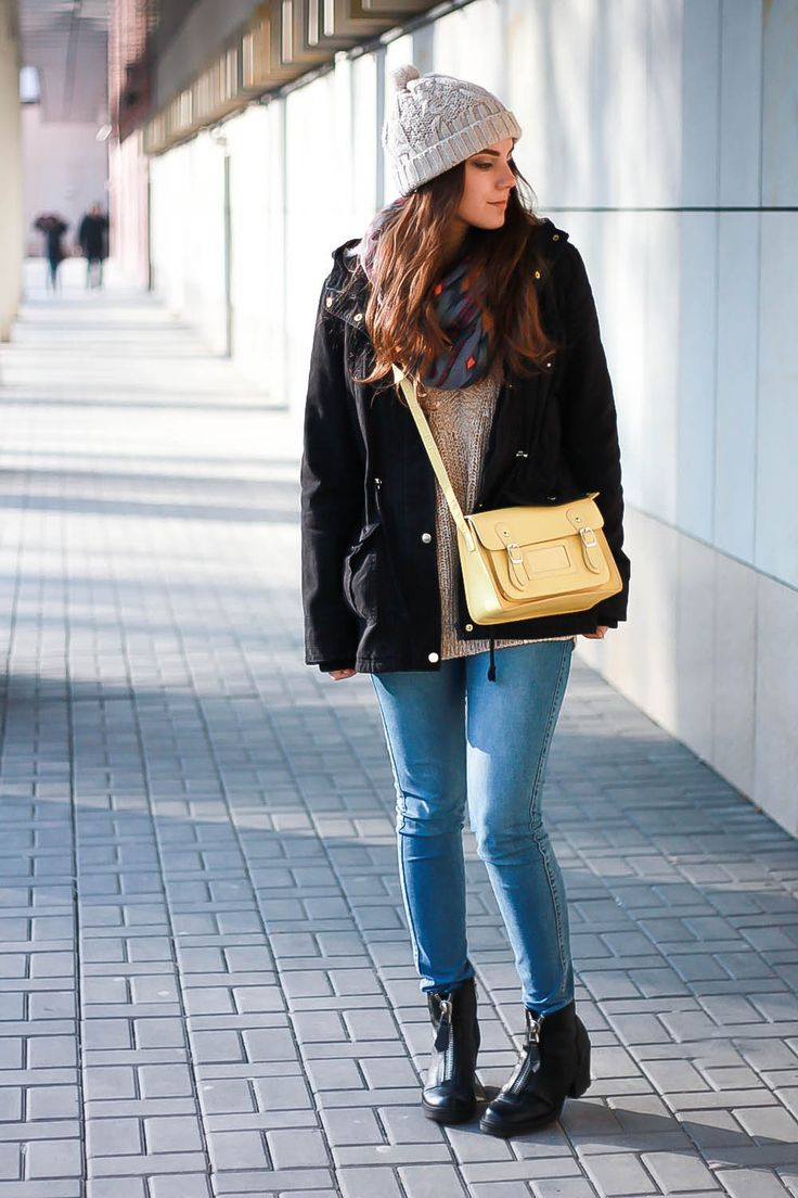 Black parka jacket, blue jeans and yellow bag. Perfect match for the coming spring. More on VANILLAMADNESS.com