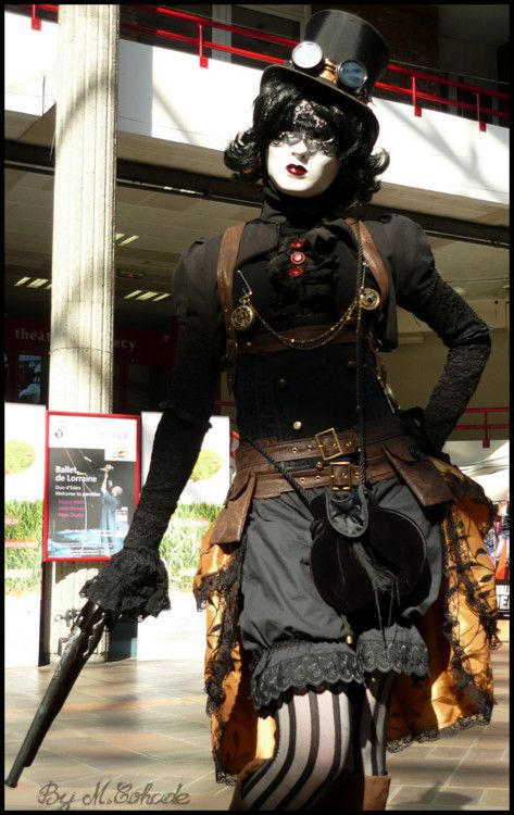 I can dig the top half of the outfit, but the face.....weird. I guess this is one of those Goth-Steampunk