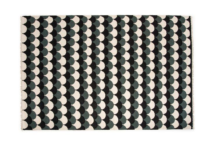 Mum's SUOMU carpet. Deep dark forest green. Design by Susanna Vento.