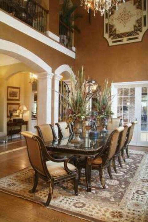 Formal Dining Room.  Beautiful table and chairs.  The urns on the table have quite lavish arrangements in them.