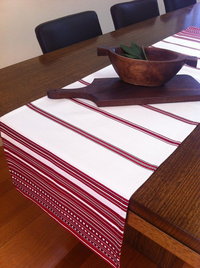 PIROSKA's Ilona range comes in cushions, tablecloth and table runner.  http://piroska.myshopify.com/collections/textiles/products/ilona-quality-handed-loomed-cotton-table-runner