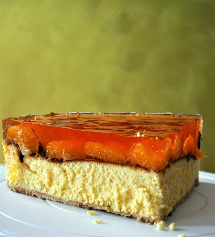 A perfect cake: baked cheesecake with tangerine pieces and orange jelly.