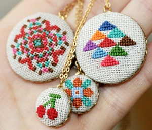 Cross stitched necklaces by Gamma Folk