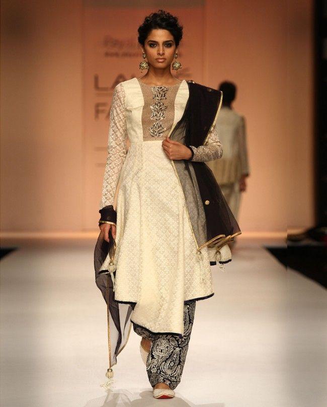 Materials: Jacquard Cotton, Velvet, Lining-Cotton Silk Cream katarva layered hem kurta with jaali work Midnight blue Pakistani pyjamas with jaal embroidery Chanderi cotton dupatta