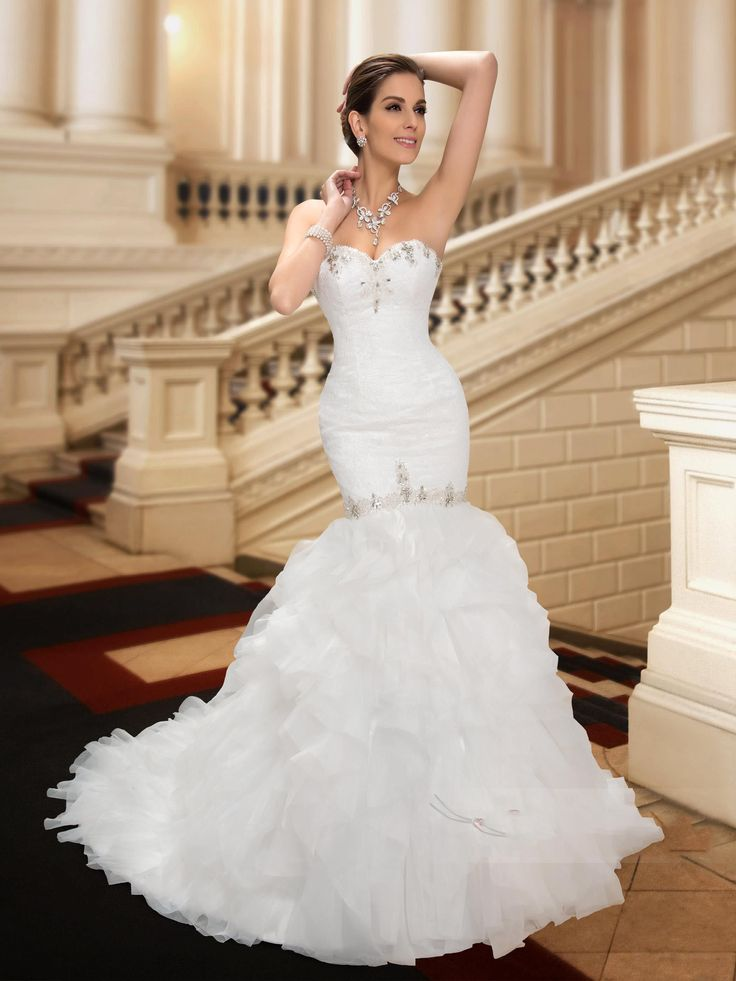 Strapless Mermaid Dress with ruffled train and beading details.