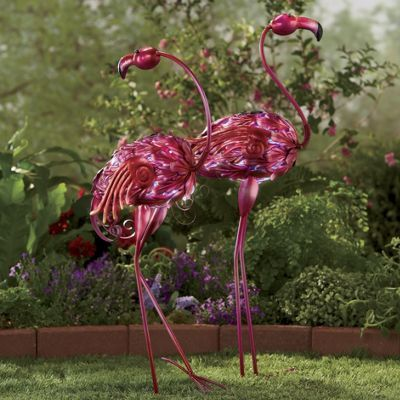 Vibrant and eccentric, this Set of 2 Pink Solar Flamingos brings a fresh look to a classic yard fixture. With a full charge, the solar LED lights make the flamingos come alive at night with light shining through the cutouts in the body. Includes one rechargeable AAA battery. Shop now!