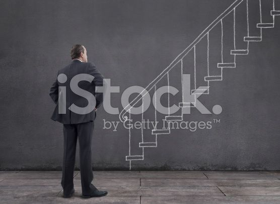 Businessman with Staircase Sketched on the Wall (royalty-free stock photo) © mgkaya
