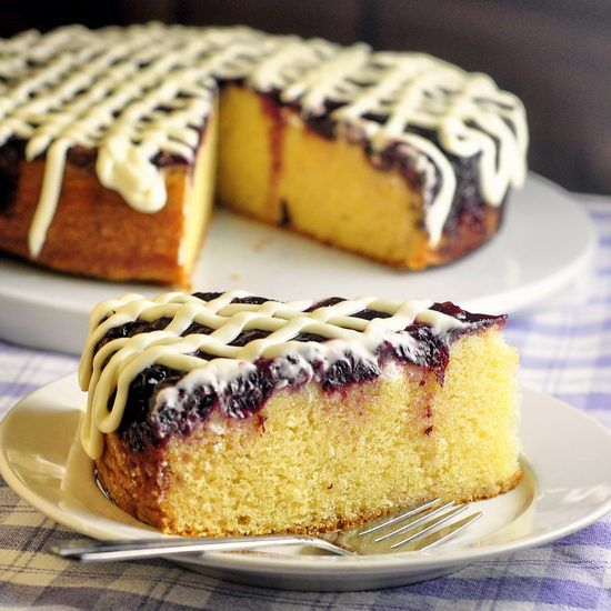 Cherry Vanilla Coffee Cake with Cream Cheese Glaze - you can use fresh cherries if they are in season or simply use frozen as I did here. The moist buttery cake is so delicious when combined with the sweet cherries and cream cheese glaze.