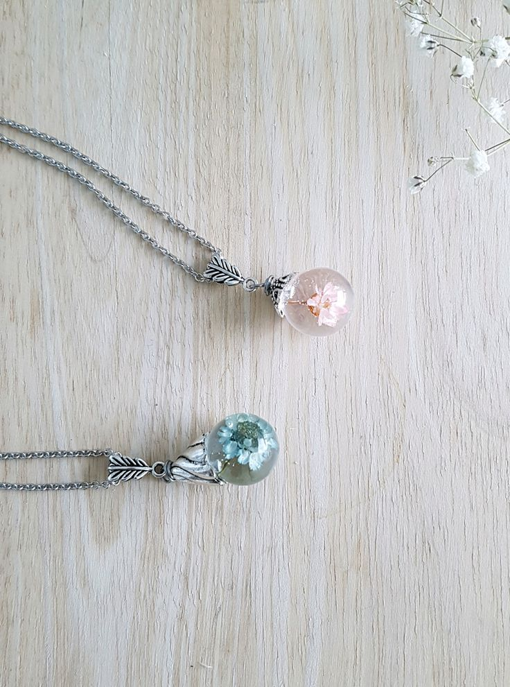 Handmade resin jewelry with real dried flowers, made in canada :)
