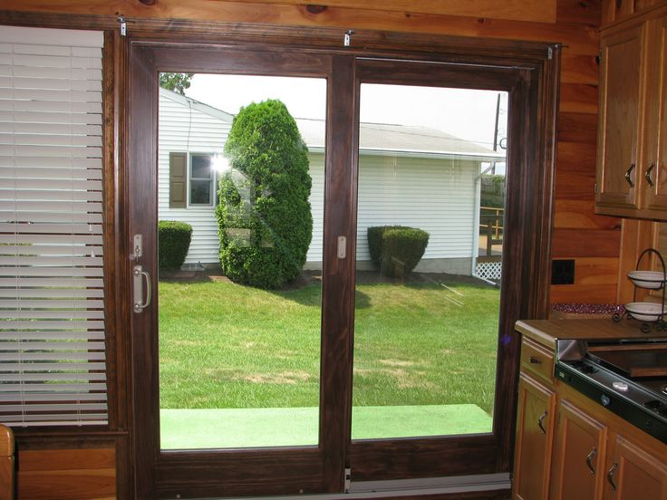 The Andersen Perma-Shield® sliding patio door has a rigid vinyl surface  layer covering