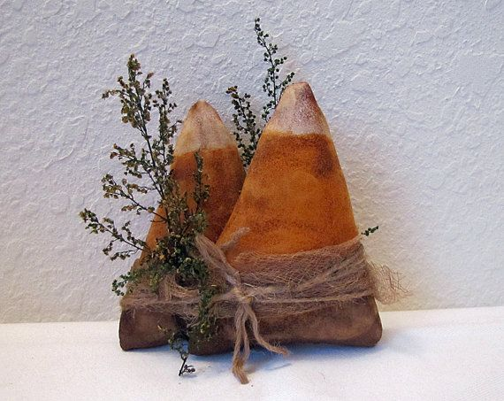 Handmade Primitive Candy Corn Tuck, Candy Corn Shelf Sitter, Primitive Halloween Candy Corn, Primitive Autumn Fall Decoration, Country Decor Primitive candy corn tucks/bowl fillers - Cave Creek style. Painted, sanded, grunged with cinnamon, wrapped with coffee-dyed muslin, jute twine, and preserved Sweet Annie. Each set is about 5 x 5 inches. **You receive 2 sets of 2 candy corns, as pictured. Thank you for shopping Cave Creek. To easily find more items in my shop: http://cave...