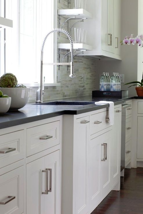 Milton Development: Contemporary kitchen design with white inset kitchen cabinets paired with black granite ...