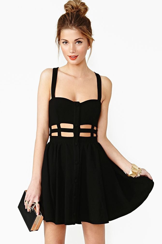 Black Skater Dress featuring a caged waist and button-down front. Insanely cool.