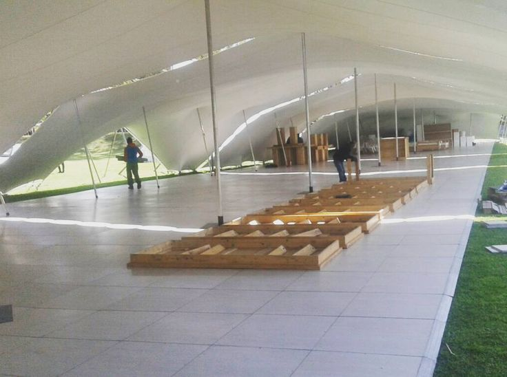 A large Pearl Teak floor outside protected from wind and rain #connectafloorcape #eventflooringcape town