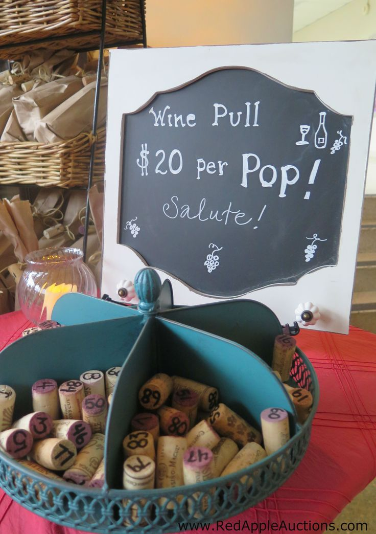 Wine pull set-up at a fundraising auction. Wine corks in a spinning lazy susan.