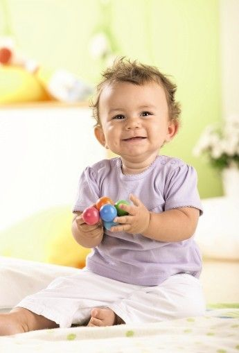 Magica Clutching Toy - Wooden Infant Rattle | HABA USA