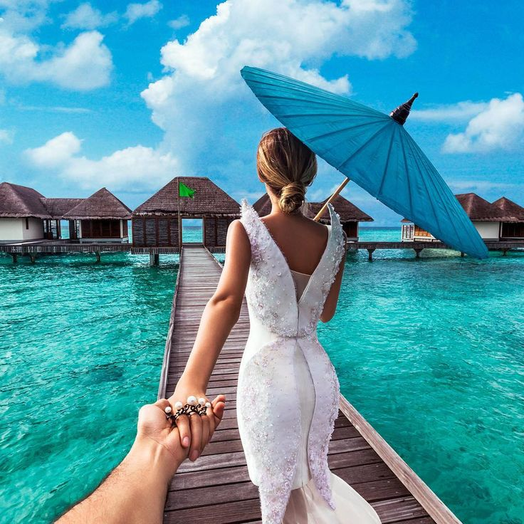 Follow me to the Maldives Islands - - Murad Osmann, //159.   The classic 'follow me'. . .   Somebody should try to do it with a long chain of people.
