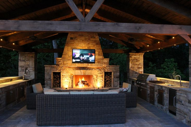 Rustic stones fire pit with outdoor tv shelves as well as for Outdoor kitchen designs with fireplace