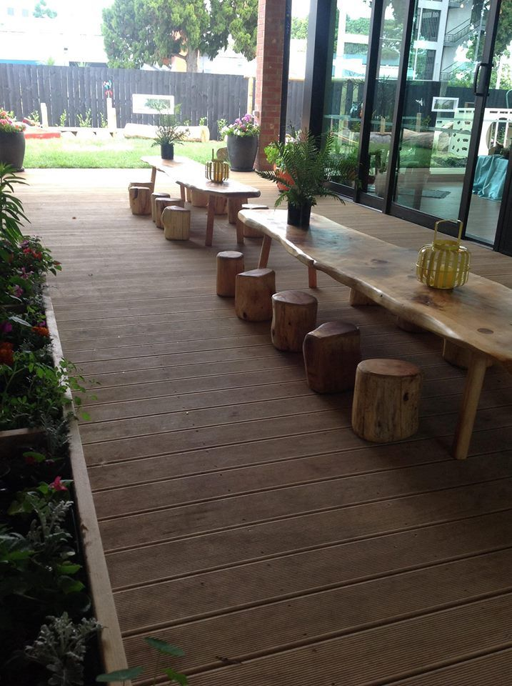 Outdoor dining area - New Shoots Tauranga ≈≈ I love these log stools and tables!
