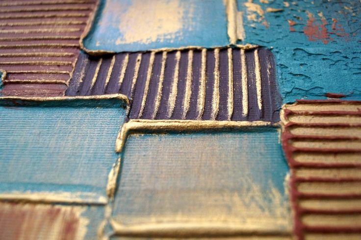 Extra groot acryl vierluik schilderij op canvas van Buttner. Abstract modern schilderij met grof opgezette verf in aqua blauw, goud en bruin. Met 10 cm tussen de panelen is de totale breedte 210 cm.