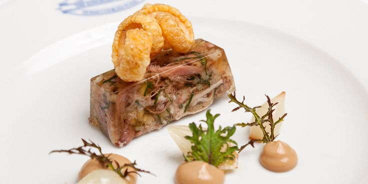 Emily Watkins has come up with a stunning pig's head terrine, complete with homemade mustard, pickled onions and crackling.