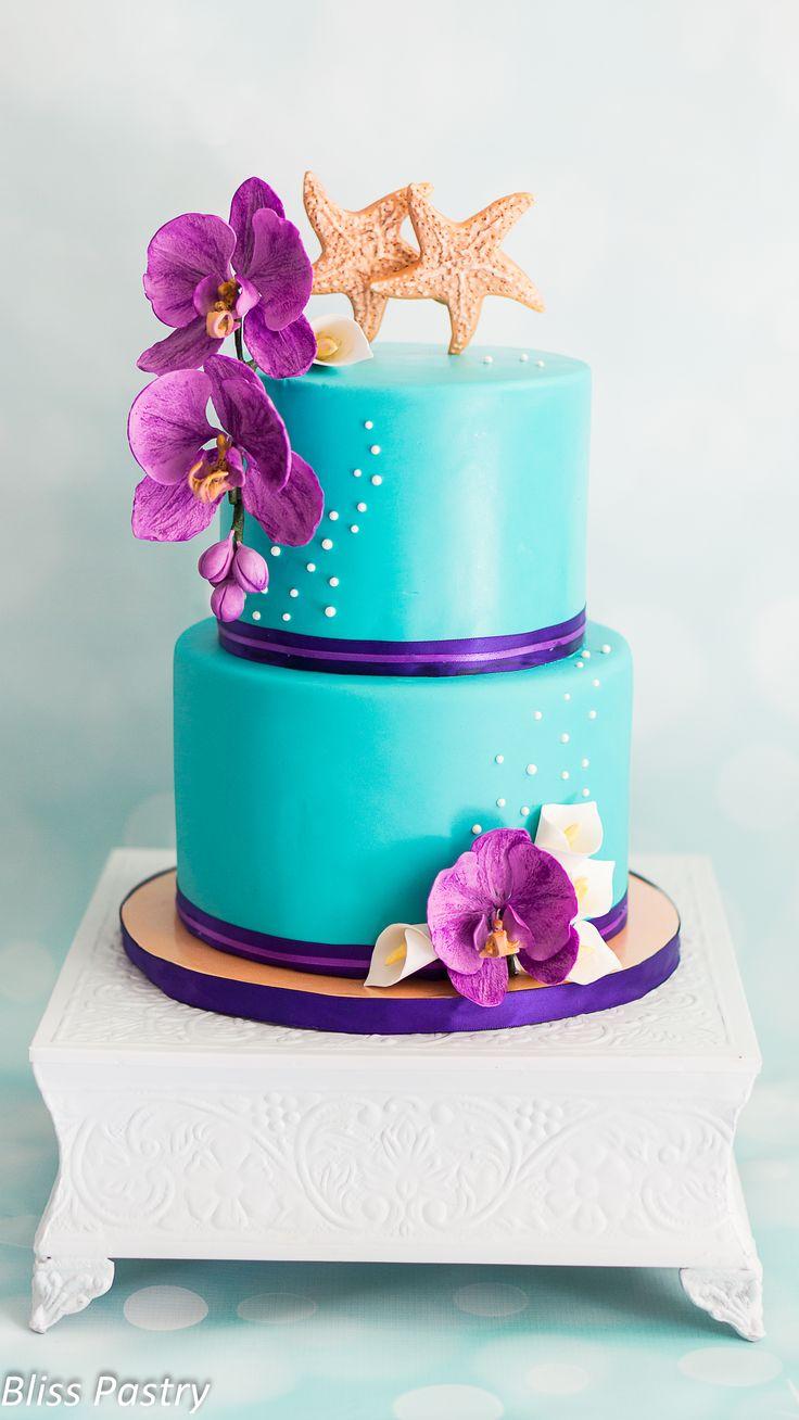 Teal and purple beach wedding cake