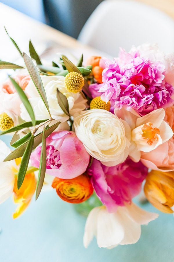 How to create a colorful spring bouquet.  Perfect for bridal showers, mother's day, and centerpieces! #bouquet #flowers #bridal #bridalshower #diy #centerpiece