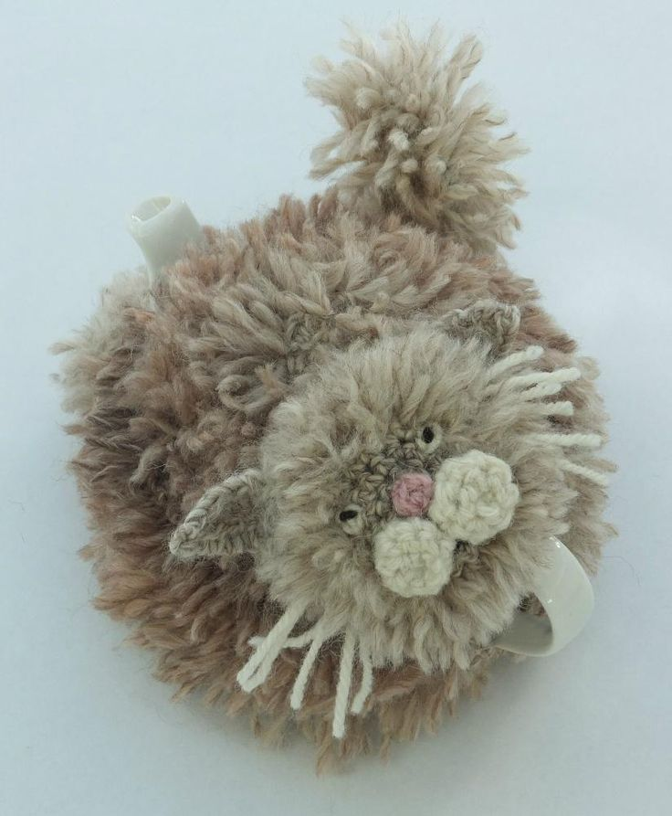 Transform your tea pot with this purr-fect tea cosy. Quick and easy to crochet using a double crochet stitch (UK) and a fur stitch (which is simply a variation on the double crochet stitch).The pattern can be adapted to fit any size tea pot and has instructions and photos on how to do the crochet fur stitch.