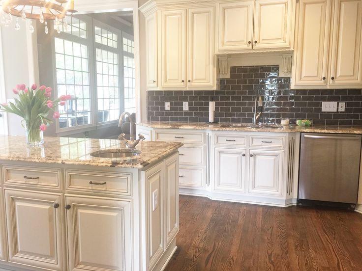 Glazed cream cabinets with dark backsplash   Cheap kitchen ...