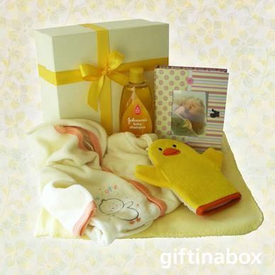 A beautiful baby gift hamper for the new arrival ... warm memories for ever! All presented in a cream box with ribbons and bows.   Full fleece baby growth with hood Johnsons baby shampoo Bath mitt Baby photo album