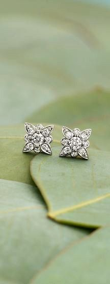 These stunning diamond earrings are beautifully detailed.