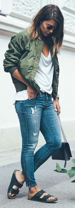 Nina + bomber jacket + androgynous edge + dying to try + plain white tee + perfect foundations + boyish chic look + jeans, sandals, and a bomber jacket + Accessorise + shades + classic look. Jeans: Diesel, Top: H&M, Shoes: Birkenstock, Bag: YSL, Sunglasses: Ray Ban, Jacket: Na-kd. More